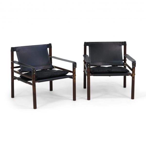 Sirocco by Norell Furniture, design Arne Norell 1964. Upholstery leather Elmo Rustical 99991 black, support/strap leather Tärnsjö 9308 black, wood stain dark brown 1323
