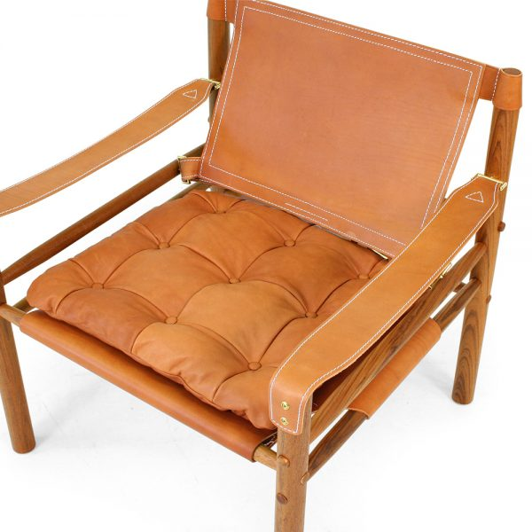 Sirocco chair by Norell Furniture. Design Arne Norell. Upholstery leather 8695 wild nature, support leather 97460 shoulder whiskey, oiled teak wood.