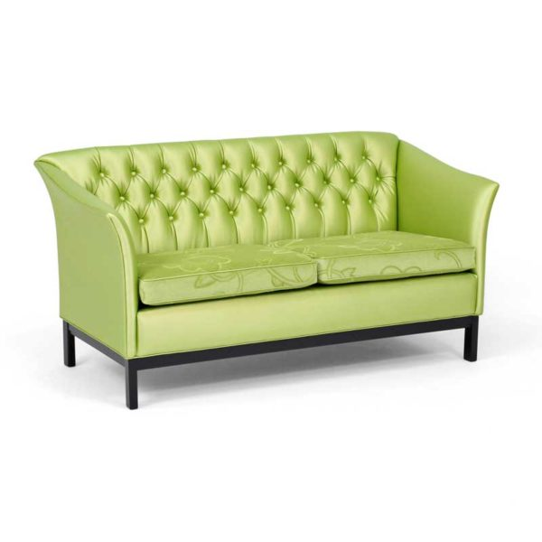 Diplomat green sofa by Norell Furniture in Sweden