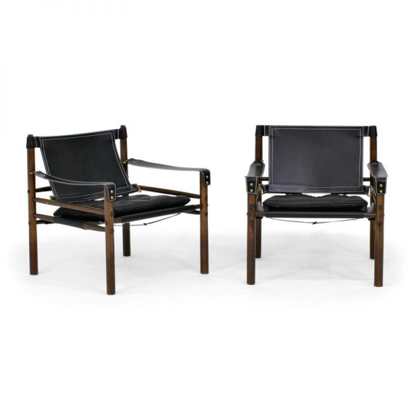 Sirocco chair by Norell Furniture. Design Arne Norell. Upholstery leather 99991 black, support leather 9308 black, stained wood 1323 dark brown.