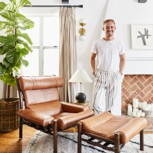 Brady Tolbert with his 'Inca' chair in Los Angeles. Design: Arne Norell, Norell Furniture Sweden.