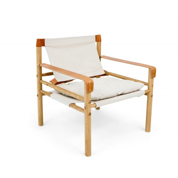 Sirocco safari chair by www.norellfurniture.com in vintage canvas and vintage wood stain. Leather details I wild nature (cognac). Design: Arne Norell 1964.