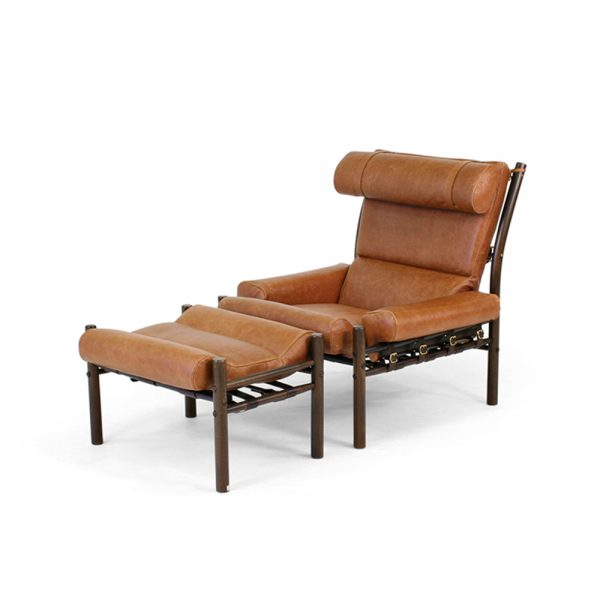 Inca chair by Norell Furniture. Design Arne Norell. Upholstery leather 33090 cognac, support leather 9368 dark brown, stained wood dark brown 1323.