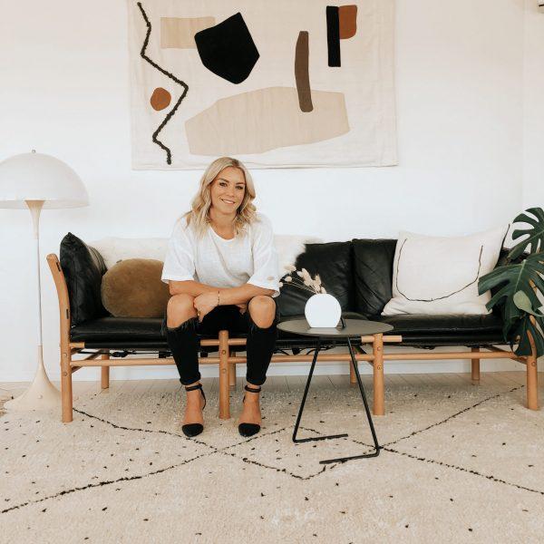 ilona black leather sofa by Norell furniture Sweden. Design Arne Norell.