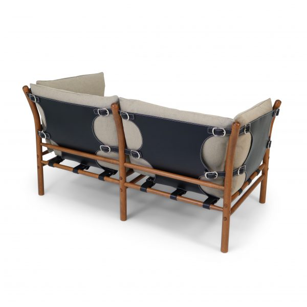 'Ilona' in dark canvas, black leather and teak-stained beech wood.