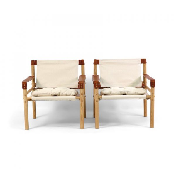 Sirocco chair by Norell Furniture in bright canvas, cognac leather and vintage ash wood stain. Design: Arne Norell 1964.