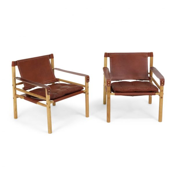 Sirocco in oiled oak and medium brown leather. Made by Norell furniture Sweden.