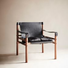 'Sirocco' chair by Norell Furniture. Black leather and black seams. Wood frame in exclusive oiled teak. Design by Arne Norell 1964. Photo by www.artilleriet.se