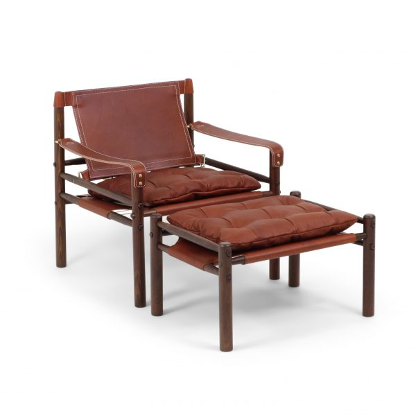 Sirocco with ottoman in medium brown leather and dark brown wood stain. Made by Norell furniture Sweden.