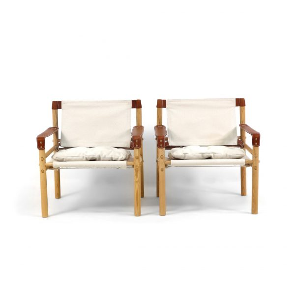 The Sirocco chair by Norell furniture Sweden. Bright canvas, vintage ash wood stain, wild nature (cognac) leather. Designed by Arne Norell 1964.
