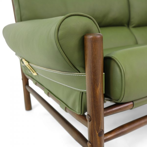Kontiki by Norell Furniture in olive green leather. Wooden beech frame with walnut stain. Design: Arne Norell 1970