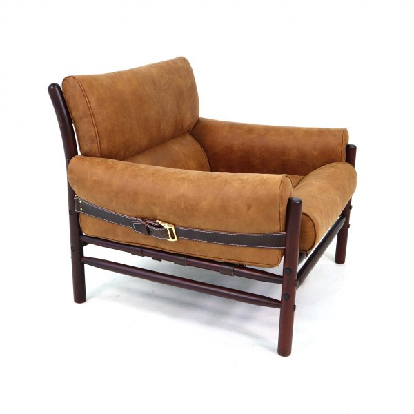 The original Kontiki chair handmade in Sweden by Norell Furniture. Design: Arne Norell 1970. Leather: Camo Bari 0303 cognac. Wood finish: rosewood stained beech. Strap leather: dark brown.