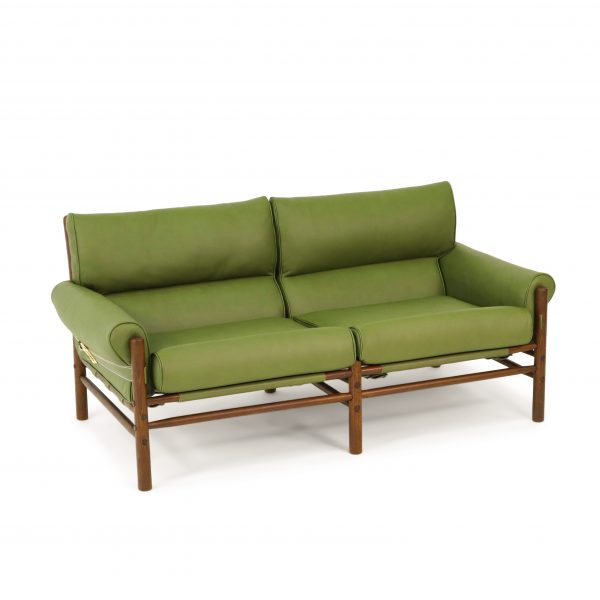 Kontiki by Norell Furniture in olive green leather specially made by Tärnsjö Garveri. Wooden beech frame with walnut stain. Design: Arne Norell 1970